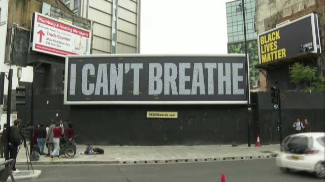black lives matter protesters in london unveil a billboard reading 'i can't breathe' the last words of george floyd and eric garner who were both... - i can't breathe stock videos & royalty-free footage