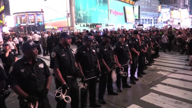 black lives matter protesters in times square with chants 'hands up don't shoot' and nypd arrests demonstrating against police shootings of alton... - sprechgesang stock-videos und b-roll-filmmaterial