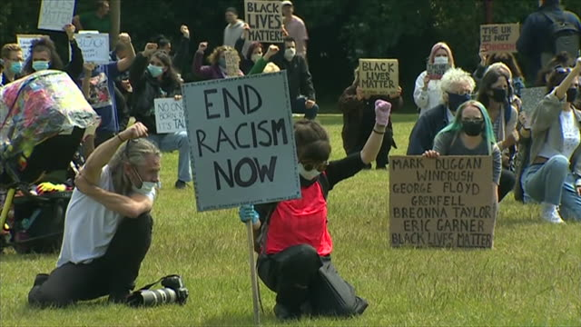 black lives matter protesters in wrexham demonstrating whilst observing social distancing protocol - ひざまずく点の映像素材/bロール