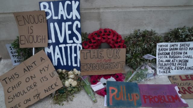 black lives matter protesters lay anti racism signs on the cenotaph on white hall in london on june 7 2020 in london united kingdom the death of an... - reclining stock videos & royalty-free footage