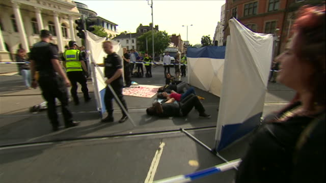 black lives matter protesters laying down on tram lines in nottingham - reclining stock videos & royalty-free footage