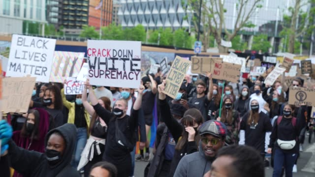 black lives matter protesters march to parliament in london on june 7, 2020 in london, united kingdom. the death of an african-american man, george... - london england stock videos & royalty-free footage