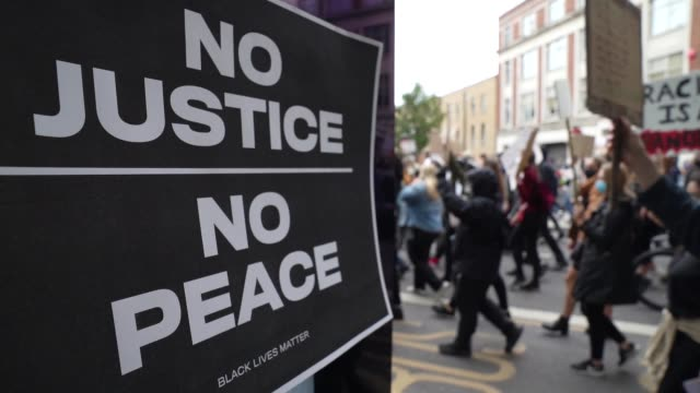 black lives matter protesters march towards parliament in london on june 7, 2020 in london, united kingdom. the death of an african-american man,... - film stock videos & royalty-free footage