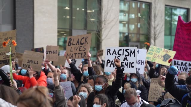 black lives matter protesters take a knee outside the american embassy in london on june 7, 2020 in london, united kingdom. the death of an... - limb body part stock videos & royalty-free footage