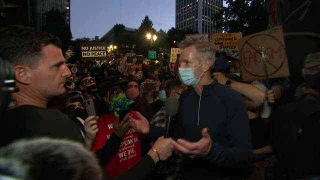 protests in orgeon / ted wheeler interview; usa: oregon: portland: federal building: ext / night ted wheeler interview as along through protesters... - portland oregon stock videos & royalty-free footage