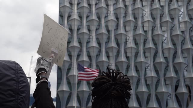 slomo black lives matter sign outside the american embassy as the usa flag flaps in the background in london on june 7 2020 in london united kingdom... - national flag stock videos & royalty-free footage