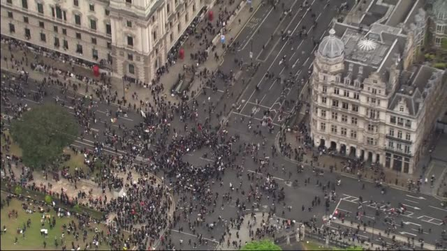 westminster and trafalgar square protest aerials england london signs and placards against railings / protesters forming circle in parliament square... - geometric stock videos & royalty-free footage