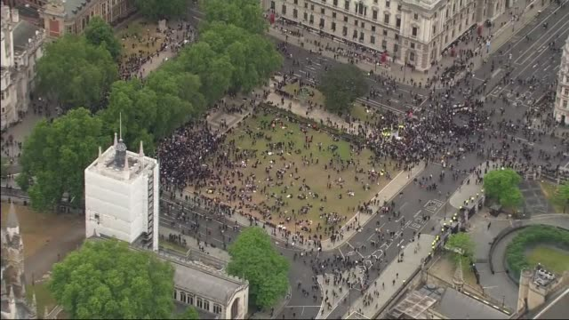 westminster and trafalgar square protest aerials england london views / aerials demonstrators and police officers surrounding statue of winston... - circle stock videos & royalty-free footage