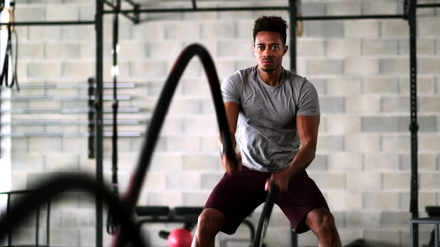 black male athlete working out with battle ropes - rope stock videos & royalty-free footage