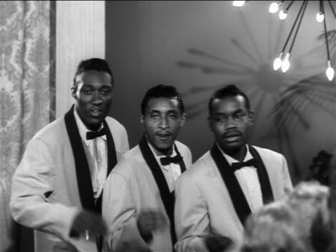 "b/w 1956 3 black male backup singers performing ""over and over again"" on small stage / the moonglows - darstellender künstler stock-videos und b-roll-filmmaterial"