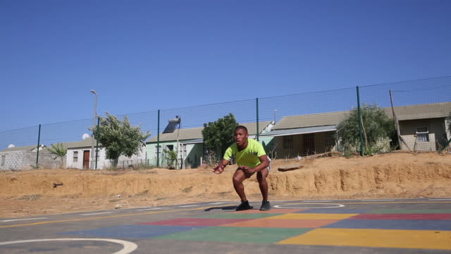 black male doing some exercises outside - sportsperson stock videos & royalty-free footage