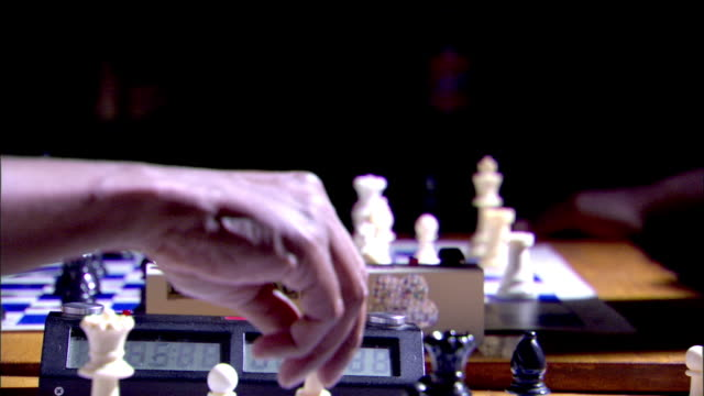 Black male hand moving arm OUT OF FRAME Hand returning w/ captured black Knight moving again Game play arm BG tournament