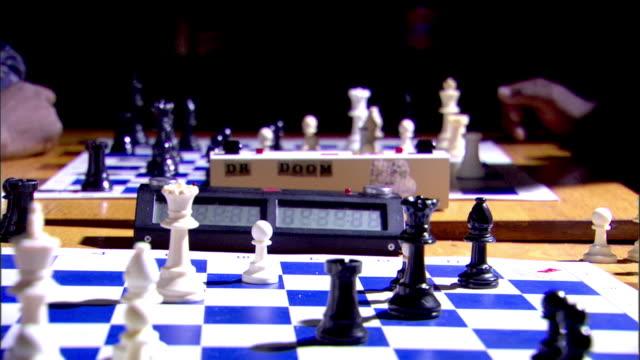 vídeos y material grabado en eventos de stock de black male hand moving arm out of frame, same movements on game table bg, tournament. - examen