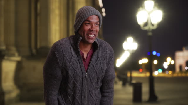 Black male in Paris, France shivering outside on freezing night
