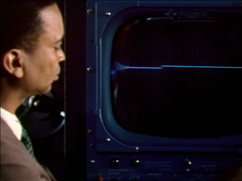 1956 black male scientist/engineer looking at waveform on monitor - scientific experiment stock videos & royalty-free footage