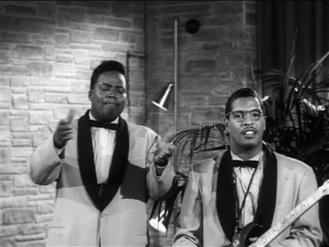 "b/w 1956 black male singer + guitarist performing ""over and over again"" on small stage / moonglows - rock group stock videos & royalty-free footage"