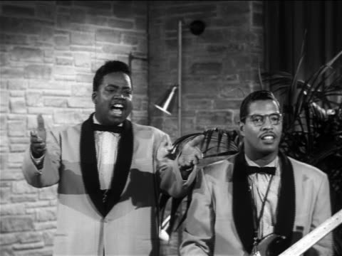 "B/W 1956 Black male singer + guitarist performing ""Over + Over Again"" on small stage / The Moonglows"