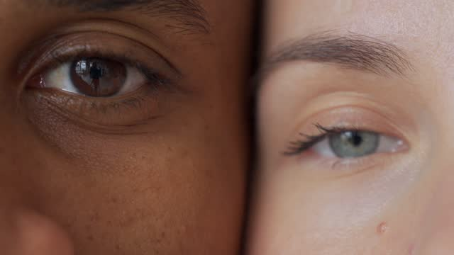 Black man and white woman's eyes.Interracial race love concept. Anti-racism