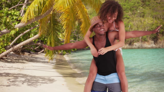 black man and woman playfully dance on the beach - vest stock videos & royalty-free footage