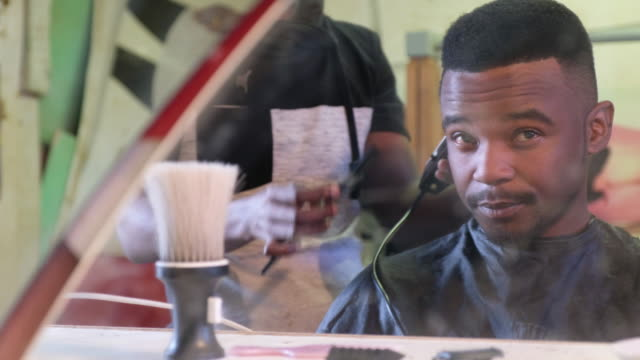 black man has his hair cut at the local barber - barber stock videos & royalty-free footage