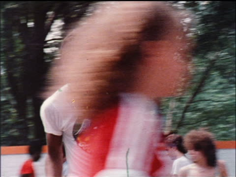 1978 black man on roller skates dancing in busy park / nyc / educational - 1978 stock videos & royalty-free footage