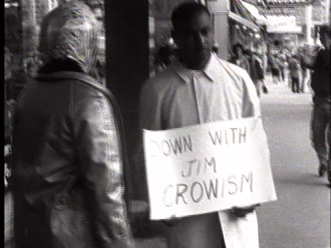 """black man pickets segregated stores on a downtown street, carrying a sign that reads """"down with jim crowism."""" - separation stock videos & royalty-free footage"""