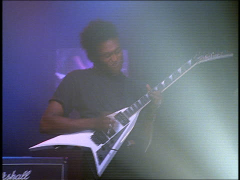 black man playing electric guitar on stage in concert - guitarist stock videos & royalty-free footage