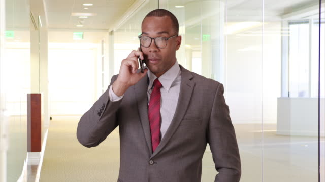 a black man uses his mobile phone for business - ladder of success stock videos & royalty-free footage