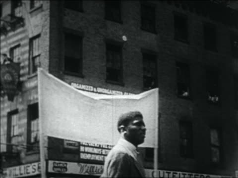 black man watching wwi veterans passing in bonus march / nyc - 1932 stock videos and b-roll footage
