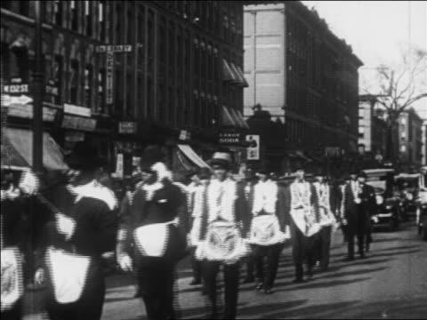 B/W 1930 Black men in costumes marching in parde on street in Harlem / New York City / newsreel