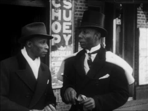 b/w 1930 2 black men in formalwear standing + talking on harlem sidewalk / nyc / newsreel - 1930 stock videos & royalty-free footage