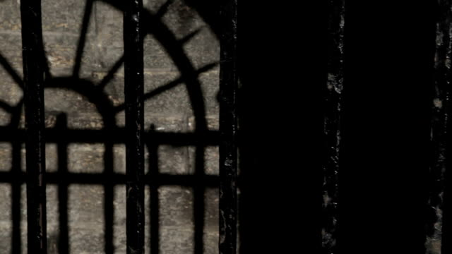 black metal bars on a cold stone prison cell - torture stock videos & royalty-free footage