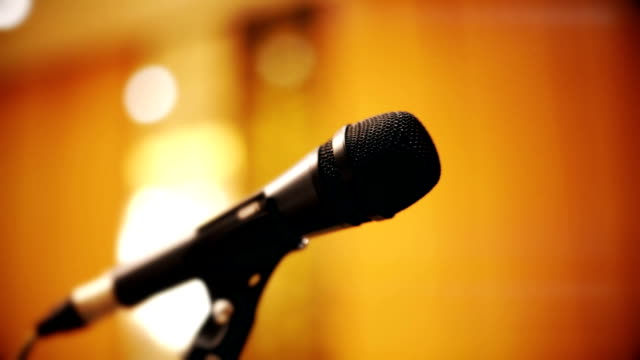 black microphone for concert on a stage. - stage performance space stock videos & royalty-free footage