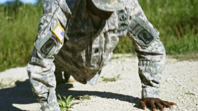 black military man in uniform performing push-ups outdoors - army exercise stock videos and b-roll footage