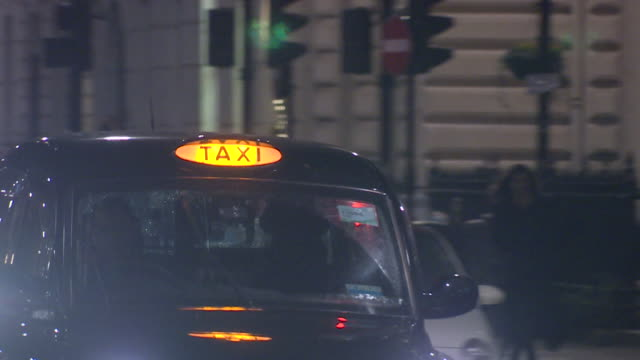 black minicabs driving in london at night - taxi stock videos & royalty-free footage
