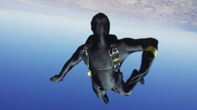 black morph suit skydiver - free falling stock videos & royalty-free footage