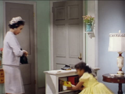 1962 black mother adjusting sunday dress on little girl + exiting / industrial - investment stock videos & royalty-free footage
