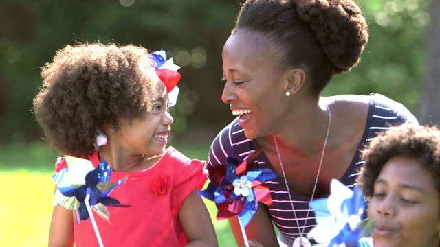 black mother and children playing on american holiday - pacific islander family stock videos & royalty-free footage