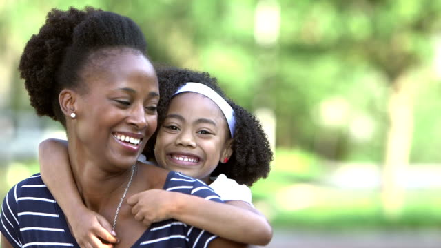 black mother with cute little girl outdoors, piggyback - single mother stock videos & royalty-free footage