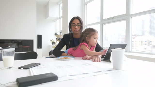 black mother working in home office with daughter - multitasking stock videos & royalty-free footage