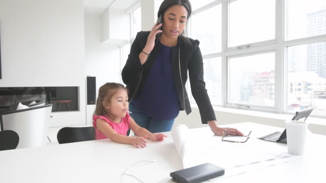 black mother working in home office with daughter - multitasking woman stock videos & royalty-free footage
