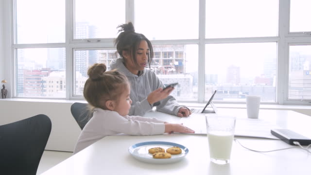 black mother working in home office with daughter - working mother stock videos and b-roll footage