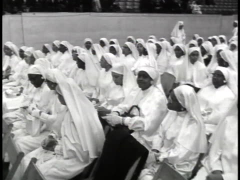 black muslim women sit in the chicago international amphitheater during a 1962 rally. - 1962 stock videos & royalty-free footage