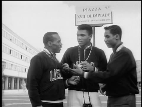 Black Olympic medalists shaking hands / Rome / documentary