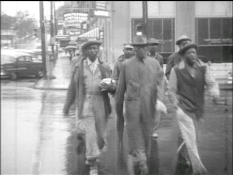 black people cross street + walk past camera / montgomery bus boycott, al / newsreel - prejudice stock videos & royalty-free footage