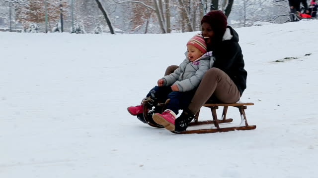 black people on the snow,winter vacations concept - sliding stock videos & royalty-free footage
