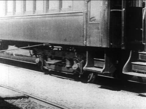b/w 1903 black porter helping people disembark from train (last woman to disembark is mary murray) - 1903 stock-videos und b-roll-filmmaterial
