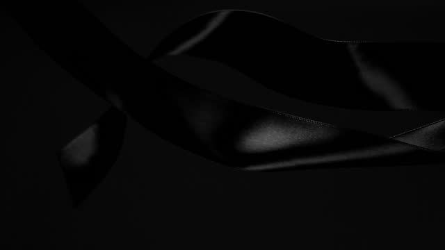 black ribbons on black background, for celebration events and party for new year, birthday party, christmas or any holidays, waiving and curling in super slow motion and close up - black colour stock videos & royalty-free footage