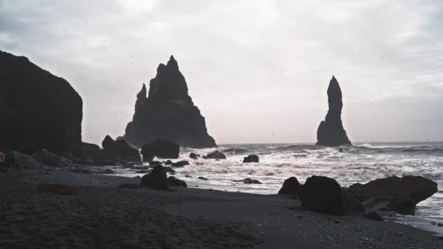 black sand beach near vik town in iceland - dyrholaey stock videos & royalty-free footage