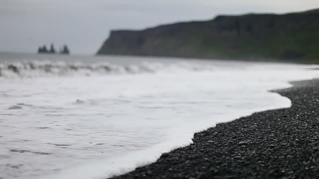 black sand beach - iceland stock videos & royalty-free footage